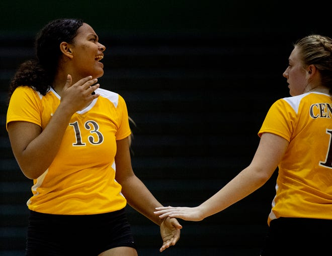 Central volleyball player Amaya Thomas (left) and a teammate celebrate during a match against North on Sept. 12, 2019.