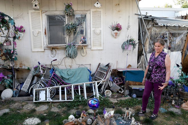 Doretta Hultquist looks at decorations in her yard at the San Souci Mobile Home Park south of Boulder on Saturday, Aug. 31, 2019. Residents say that after Colorado-based RV Horizons bought the property in 2018, rents were raised, the company started charging residents for well water and strict rules were put in place governing anything from lawn care to what kind of curtains can be hung.