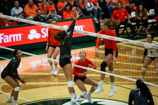 Colorado State University senior middle blocker Kirstie Hillyer (13) spikes the ball during a game against rival University of Colorado on Thursday, Sept. 12, 2019, in Fort Collins, Colo.