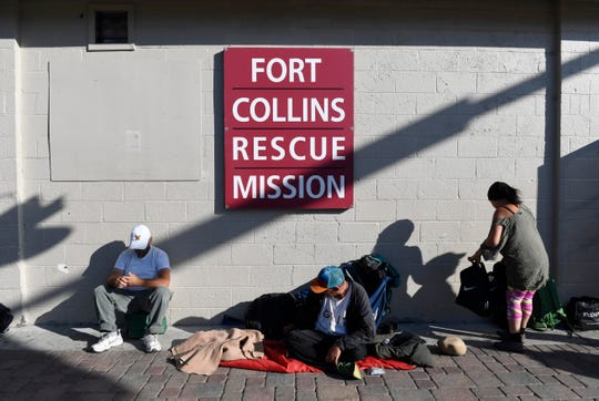 People line up for dinner outside the Fort Collins Rescue Mission in Fort Collins, Colo. on Sept. 12, 2019.