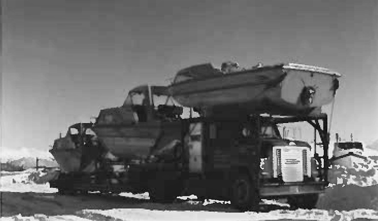 A picture of one of the three trucks loaded with boats manufactured at Cruisers in Oconto that Roger Stewart and two other drivers hauled to Alaska in March 1973. It was the first time the company trucked boats to Alaska..