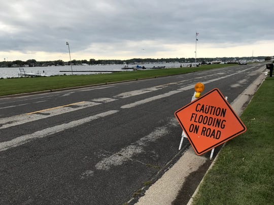 A sign warning of flooding on Sturgeon Bay's Memorial Drive this summer. It flooded Wednesday, this time as a result of winter conditions.