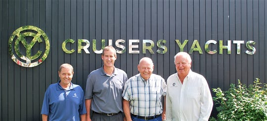 Posing for a photo at Roger Stewart's retirement party on July 30 were his supervisor, traffic manager Steve Brazeau, company president Mark Pedersen, Stewart, and company owner K.C. Stock. Stewart thanked Stock with providing good equipment to deliver the company's boats with, and thanked his co-workers for their friendship over his 60 years with the company.