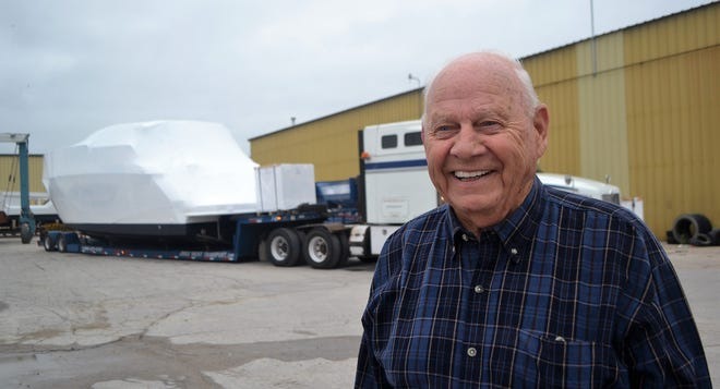 Roger Stewart of Oconto is seen behind the Cruiser Yachts plant in Oconto with a semi-truck prepared to haul a 55-foot boat for delivery. Stewart retired this summer after 60 years of making boat deliveries across the country for the company.
