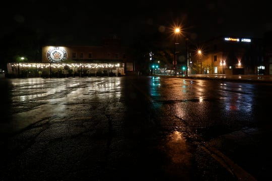 A steady rain falls overnight Thursday, September 12, 2019, off Dousman Street in downtown Green Bay, Wis.