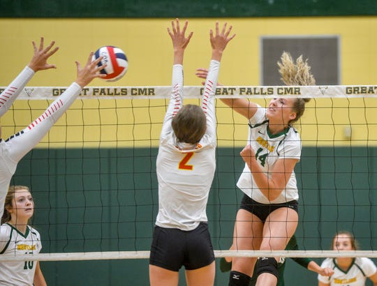 CMR's Allie Olsen spikes at the net against Missoula Hellgate during the Great Falls Invitational Volleyball Tournament.