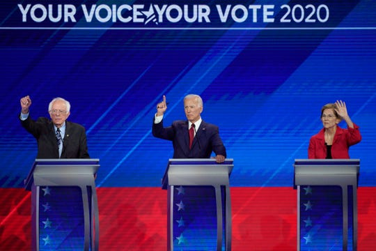 From left, Democratic presidential candidates Sen. Bernie Sanders, I-Vt., former Vice President Joe Biden and Sen. Elizabeth Warren, D-Mass. raise their hands to answer a question Thursday during a Democratic presidential primary debate hosted by ABC at Texas Southern University in Houston.