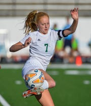 CMR's Emily Funseth plays the ball off the side of her foot during Thursday's crosstown soccer match against Great Falls High.
