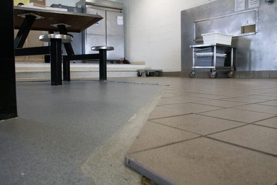 The rubber transition piece between the tile and floor is missing in the high-security cafeteria, creating difficulties for disabled inmates. According to prison officials, the high-security cafeteria floor has been replaced and repaired several times since the prison opened in 1977.
