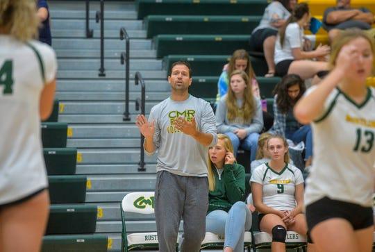 CMR volleyball coach Patrick Hiller gives instructions to his players in their match against Hellgate during the Great Falls Invitational Volleyball Tournament.