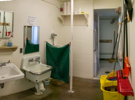 In low-security housing at the Montana State Prison in Deer Lodge, 17 inmates share one bathroom facility per unit. The low-security housing was originally designed to house 12 inmates per unit, but due to a growing population 17 inmates occupy the unit.