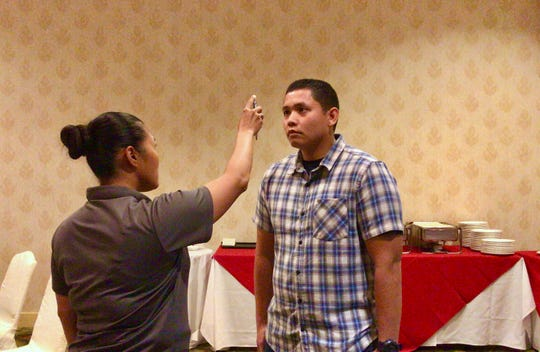 Guam Police Department officer Harrilee Matsumoto, left, on Sept. 13 demonstrates on police officer trainee, Sean Magada, right, one of the tests in a standardized field sobriety test, used to help determine if a person is under the influence.