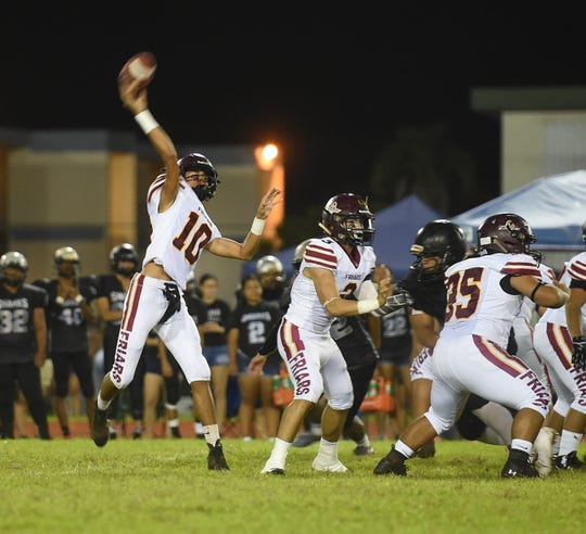 Father Duenas quarterback Nicholas Anderson (10) makes a pass during a IIAAG High School Football game at the George Washington High School Field in Mangilao, Sept. 13, 2019. The Friars came away with a 34-6 win to improve their record to 4-0.