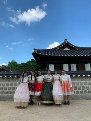 "From left: University of Guam students Cai Aquinde, Ikea Anne Natividad, and Sandra Lavina dressed in traditional Korean clothing with three other international students as part of the ""Feeling Korea"" study abroad program from July 29 to Aug. 9 at Chonbuk National University in Jeonju, South Korea. Aquinde and Natividad are secondary education majors, and Lavina is majoring in computer science. The students funded their travel by volunteering to help with UOG's English Adventure Program, which hosts international students in learning Guam's culture and the English language."