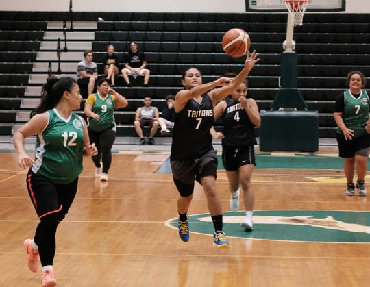 Jacether Andrew passes the ball in an 84-18 rout of the Tridents Sept. 12 in the PBS Guam Women's Basketball League at the UOG Calvo Field House.