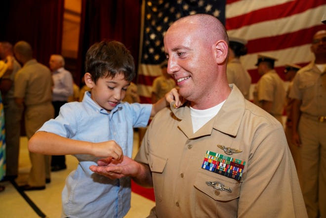 Chief Yeoman (Sel.) David O'Leary, assigned to USS Frank Cable (AS 40), is pinned to the rank of chief petty officer by his son on Sept. 13,