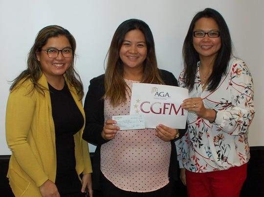 "The AGA Guam Chapter awarded the ""CGFM Scholarship"" to Clariza Roque during their August 28 general membership meeting.    Ms. Roque passed all the required exams for the certified government financial manager professional designation in July and was certified in August. She is the first recipient of the AGA Guam Chapter's CGFM Scholarship for Program Year 2020.  Pictured from left: Debbie Ngata (chapter president),  Clariza Roque and Maripaz Perez (professional certification director)."