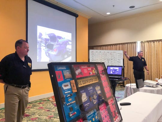Officer Gary Martens and Sgt. Glen Glaser Jr., with California Highway Patrol, address local law enforcement officers during  training on Advanced Roadside Impaired Driving Enforcement on Friday, Sept. 12 at the Pacific Star Resort & Spa.