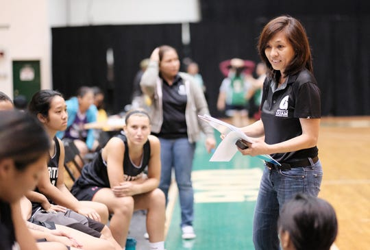 UOG coach Cecile Olandez talks to her team during an 84-18 drubbing of the Tridents Sept. 12 in the PBS Guam Women's Basketball League at the UOG Calvo Field House.