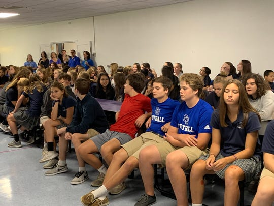 Sacred Heart students wait in the cafeteria Friday, Sept. 13, 2019, to hear an announcement that turned into a family reunion.