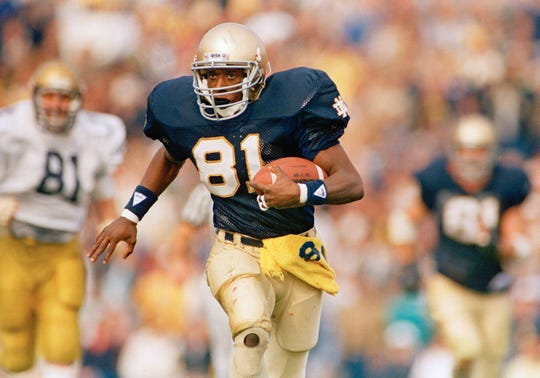 FILE - This is a 1987 file photo showing Notre Dame football player Tim Brown. Brown.
