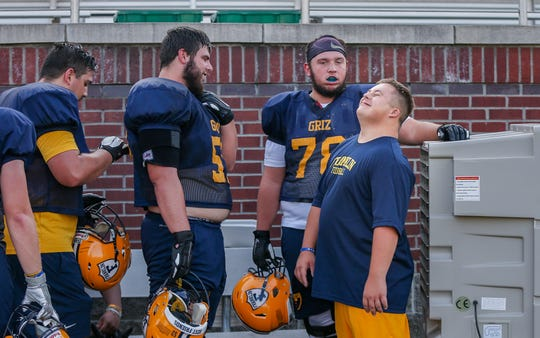 Emry Himes and Franklin players cool off in front of a fan during practice.