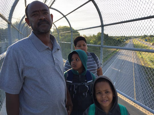 Following a district rezoning, Mogahid Gasmelseed walks his three sons to Weber Elementary every school day. Living less than two miles from the campus, the family does not qualify for busing.