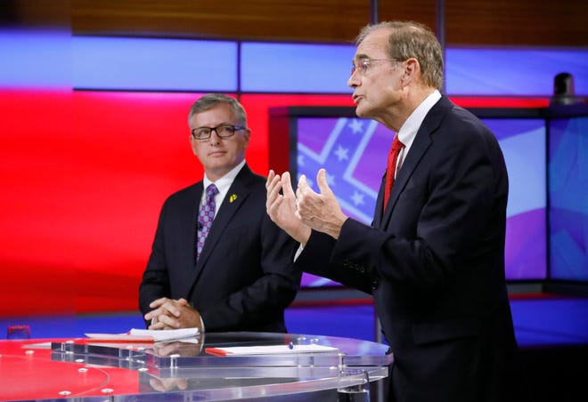 Rep. Jay Hughes, D-Oxford, left, listens as Republican Secretary of State Delbert Hosemann answers a question during their televised lieutenant governor debate in Jackson, Miss., Thursday, Sept. 12, 2019.