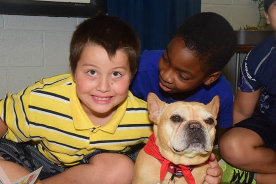 Braden Pressley and Dami Kuku are all smiles when it's their turn to pet Gus at Hardin Valley Elementary School Wednesday, Sept. 11.