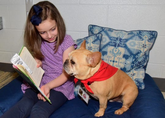 """Amelia Kilgore reads to Gus during the """"Ruff Reading Program"""" at Hardin Valley Elementary School on Wednesday, Sept. 11."""