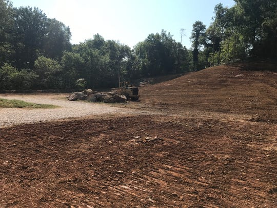 A bulldozer awaits use Sept. 13, 2019, at the official groundbreaking for the Flats at Pond Gap on Hollywood Road.