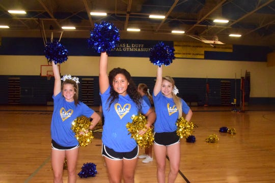 Hannah Little, 13, Zaibree Westmoreland, 11, and Emily Zimmerman, 13, practice their pom skills at cheer practice at Karns Middle School Wednesday Sept. 11.