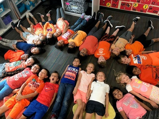 Students at Winding Creek Elementary School in Mechanicsburg, Pennsylvania, wore orange to stand up against bullying on Sept. 12 after being inspired by the story of a Florida boy who was made fun of for wearing his homemade University of Tennessee shirt to school.