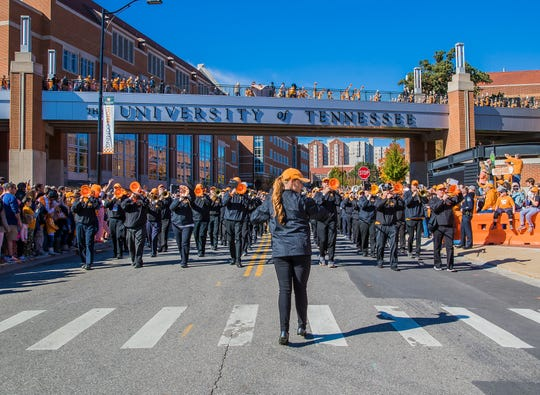 Fans gather to watch the alumni band from the University of Tennessee perform prior to Homecoming 2018.