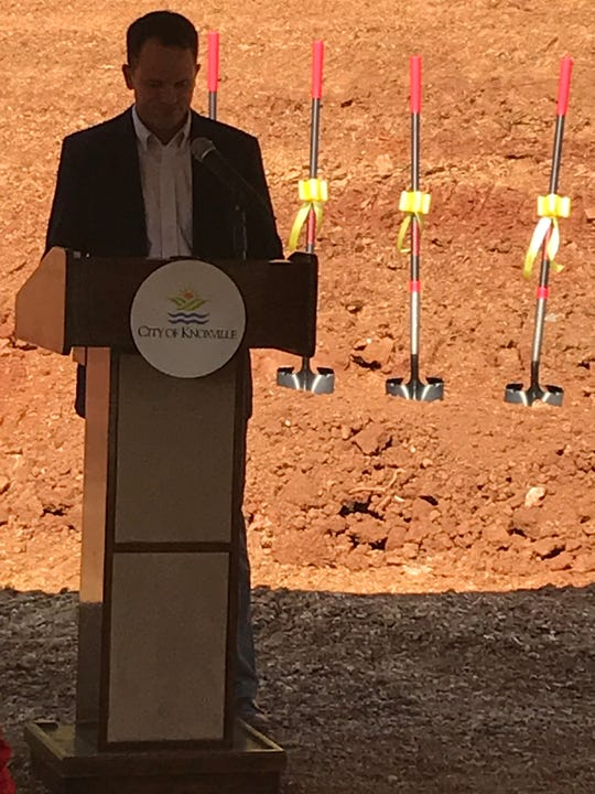 John Shepard of Elmington Capital speaks in the shade of a tent at the Sept. 13, 2019, groundbreaking for the Flats at Pond Gap.