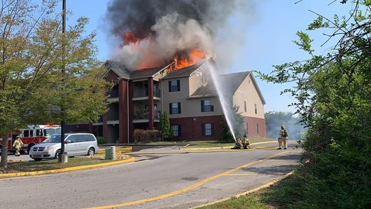 Firefighters battle a blaze at Riverpark Apartments off Old Knoxville Highway in Sevierville on Friday, Sept. 13, 2019.