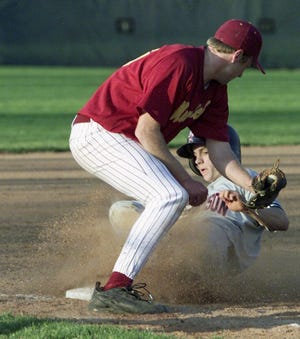 -  -By Frank Oliver/Journal and Courier -- McCutcheon's Tristan McIntyre can't get the tag down on Harrison's Tony Hill as Hill steals third base as the Mavericks fell to rival Harrison on Thursday April 11, 2002 in Lafayette. The final score was 7-5. Hill stole two bases in the 6th inning.