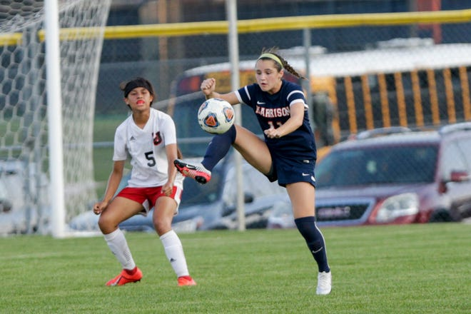 Harrison's Lexi Fraley (11) reaches up to control the ball during the first half of an IHSAA girls soccer match, Thursday, Sept. 12, 2019 in West Lafayette. Harrison won, 5-0.