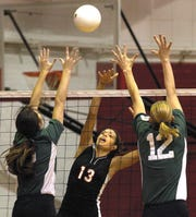 Ul volleyball player Priscilla Lima (13) hits the ball past North Texas' Jill Ruskowski,left, and Tanya samples,right, Sunday Nov. 17, 2002 during their match