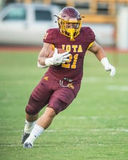 Iota High running back Luke Doucet (21) runs the ball and tries to get to the outside as the Iota Bulldogs take on the Welsh Greyhounds Thursday, Sept. 12, 2019.