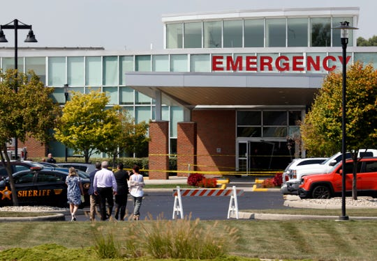 Officials representing Diley Ridge Medical Center, Fairfield Medical Center and Mount Carmel Health System walk back toward the Diley Ridge emergency department entrance Friday afternoon, Sept. 13, 2019, in Canal Winchester. Firefighters and law enforcement officers were called to the center's emergency room Friday morning after a pickup truck was driving through the facility's doors. One person died and three were injured.