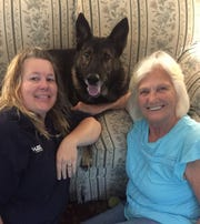 Camden resident Sherry Barker (left) and Hudson resident Sharon Farrell (right) pose for a photo on Friday Sept. 13, 2019 with TJ, Farrell's dog. A retired Michigan State Police K-9 officer at the Brighton post, TJ was shot on Sept. 2 by an unknown assailant. Funds are being raised toward his recovery.