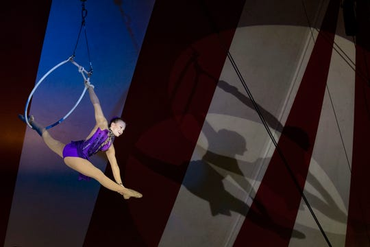 Sofia Petrov performs on the lyra during the Venardos Circus on Thursday evening at Waterfront Park's Brown-Forman Lawn. Sept. 12, 2019