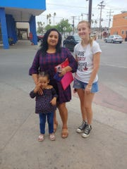Keyla, left, and her daughter Briana, front, are trying to reunite their family. They are being aided by Vonnette Monteith, whose daughter Maddie stands right.