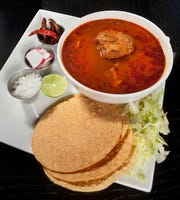 Pozone is a traditional Mexican dish made with either chicken or fish.