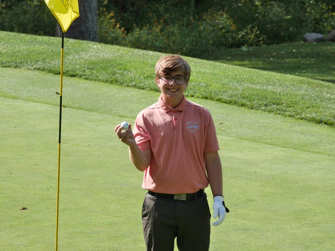 Shelby junior Eli Winchester poses with his hole-in-one ball after sinking his very first shot of the day on Wednesday in a Mid-Ohio Athletic Conference match against Clear Fork at Deer Ridge Golf Course.