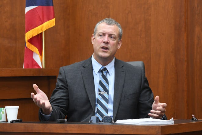 Mansfield police Det. Terry Butler testifies on Friday during the Guy Mitchell trial.