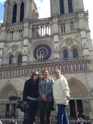 This is a behind-the-scenes photo of Beth Castle, Marcy Gilber and Madonna Thunder Hawk on location filming in Paris.