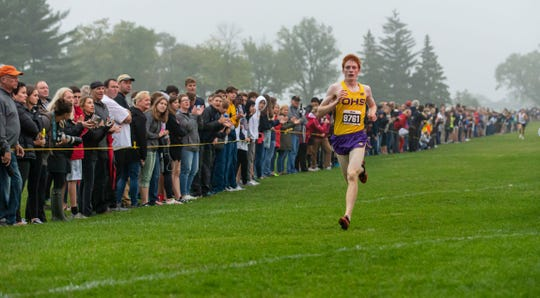 Oconomowoc senior Alexander Vance cruises to a victory at the Arrowhead Cross Country Invitational in Hartland on Thursday, Sept. 12, 2019.