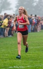 Homestead junior Leane Willemse finishes fourth at the Arrowhead Cross Country Invitational in Hartland on Thursday, Sept. 12, 2019.